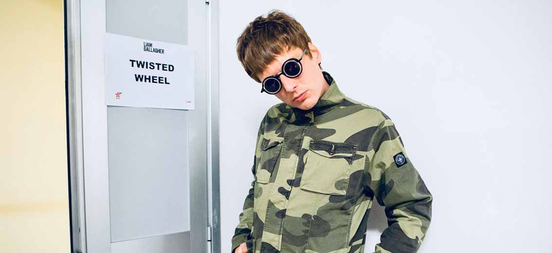 jonny brown twisted wheel frontman wearing Three Stroke Productions sunglasses during the liam gallagher european tout in 2020